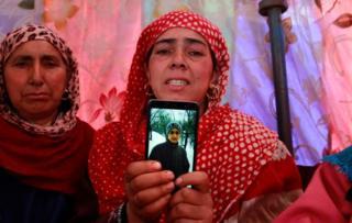 Faizan Fayaz Dar's mother with his photograph