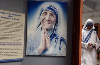An Indian nun from the Catholic Order of the Missionaries of Charity leaves after taking part in a mass to commemorate the 105th birthday of Mother Teresa at the Indian Missionaries of Charity house in Kolkata on August 26, 2015.