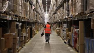 A worker walks through the Amazon facility in Swansea