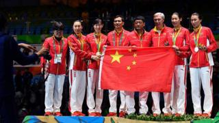 China's team celebrate their silver medal on the podium after the womens team epee fencing event of the Rio 2016 Olympic Games