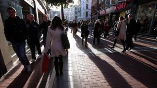 People walk along Grafton Street, the main shopping area of Dublin