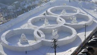 This particular photo taken February 4, 2017 shows the snow sculpture shaped of the Olympic rings at the town of Hoenggye