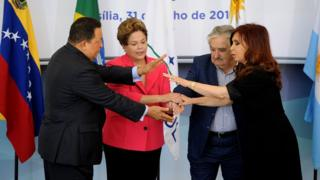Brazilian President Dilma Rousseff (2nd-L) holds hands with the presidents of Uruguay, Jose Mujica (2nd- R), Argentina, Cristina Kirchner (R), and Venezuela, Hugo Chavez ( L), before the Mercosur Extraordinary Summit, at Planalto Palace, in Brasilia, on July 31, 2012