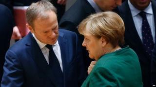 Angela Merkel talking to Donald Tusk