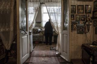 Arusyak prepares coffee in her home