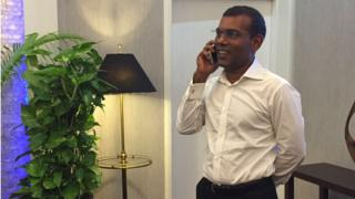 Opposition leader Mohamed Nasheed talks on the phone as he prepares to leave the Maldives (MDP handout) (18 January 2016)
