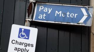 A sign above a disabled car parking bay