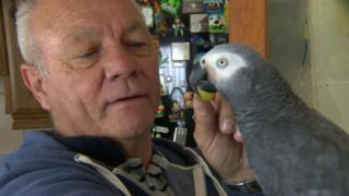 Patrick Doherty at home with his parrot