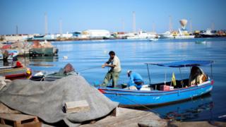 Libyan fishermen moor their boat at Tripoli harbour, Libya November 3, 2017.