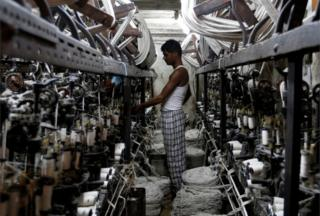 An employee works inside a garment factory in Mumbai, India February 28, 2017