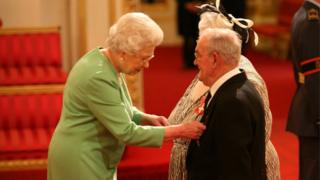 Penelope Jones and Ronald Jones as they receive their MBEs from the Queen