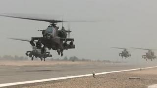 An image grab taken from a handout video released by the Egyptian Defence Ministry on 25 November 2017 shows US-made Egyptian army Apache attack helicopters flying from an airfield