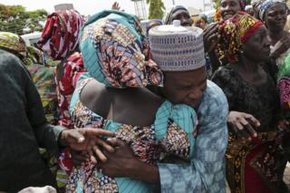 A father being reunited with one of the released Chibok girls in Abuja.