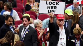 Trump supporter with 'Lock Her Up' sign
