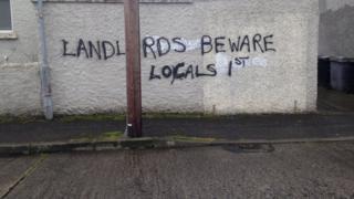 graffiti says Landlords beware locals first