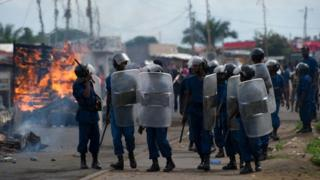 Police walk with shields through the Cibitoke neighbourhood of Bujumbura during May 2015 clashes