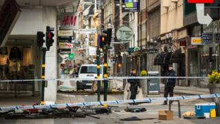 Debris at the scene of the terrorist attack where a truck crashed after driving down a pedestrian street in downtown Stockholm on April 8, 2017