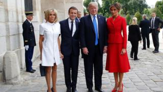 French President Emmanuel Macron (2L) poses next to his wife Brigitte Macron (L), US President Donald Trump and US First Lady Melania Trump outside the Army Museum