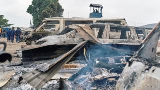 Burned vehicles are seen at the front gate of the Makala prison after it was attacked by supporters of jailed Christian sect leader Ne Muanda Nsemi in Kinshasa, Democratic Republic of the Congo