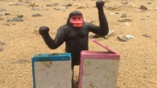 A toy gorilla with two HP cartridges