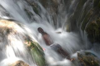 Pilgrims bathe at a waterfall