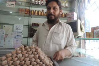 Ahmar Mehmood a.k.a. Ahmar Badayuni (sic), and a tray of Badauni pedhe - taken inside Badauni Pedha House, Bank Road, Mardan