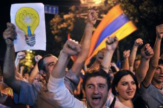 Protesters shout slogans during a demonstration against an increase of electricity prices in Yerevan early on 25 June 2015