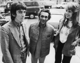 August 1972: Former Beatle George Harrison (1943 - 2001) with his wife, model Patti Boyd and sitar player Ravi Shankar (centre)