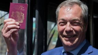 Nigel Farage holding a passport