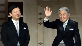 This file photo taken on 2 January 2015 shows Japan's Emperor Akihito (R) waving to well-wishers beside Crown Prince Naruhito during their new year greetings in Tokyo