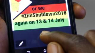 A man reading a message to shutdown Zimbabwe