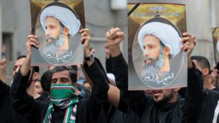 Protesters hold up posters showing the executed Shia cleric Sheikh Nimr al-Nimr at a protest in Qatif, Saudi Arabia (8 January 2016)