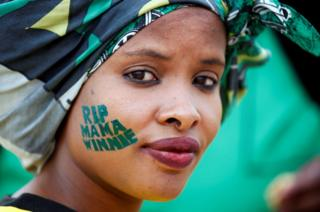 An African National Congress (ANC) supporter at a memorial service for Winnie Madikizela-Mandela at Orlando Stadium in Johannesburg's Soweto township, South Africa, 11 April 2018.