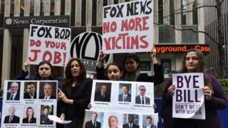 Sonia Ossorio President, National Organization for Women of New York (C) and other women hold a protest in front of the News Corporation Headquarters in New York April 20, 2017 the morning after Fox News officially cut ties with Bill O'Reilly over sexual harassment allegations.