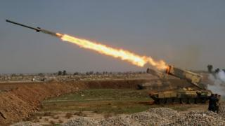 Iraqi security forces launch a rocket against Islamic State militants positions during clashes in the western side of Mosul, Iraq, Sunday, March 5, 2017