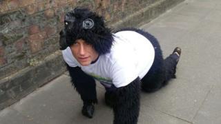 Gorilla man crawling on pavement