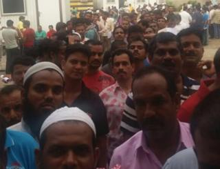 Indian men seeing queuing for food in Jeddah - 31 July 2016