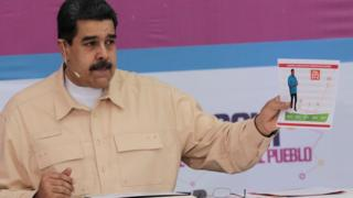 President Nicolas Maduro speaks during his weekly radio and TV promote Sundays with Maduro in Caracas, Venezuela, Dec 3, 2017