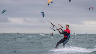 Kitesurfers take part in Virgin Kitesurfing Armada Festival at Hayling Island