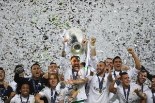 Sergio Ramos of Real Madrid lifts the Champions League trophy after victory in the UEFA Champions League final