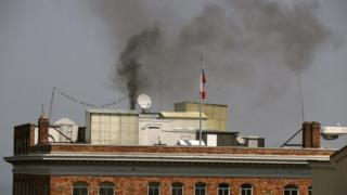 Black smoke billows from a chimney on top of the Russian consulate on 1 September 2017 in San Francisco, California