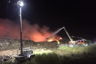 Fire crews work to extinguish a blaze at a recycling factory in Melbourne