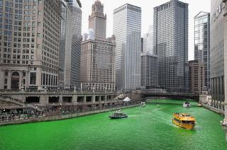 Boats navigate the Chicago River shortly after it was dyed green.