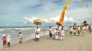 Balinese Hindus go to the beach before the Day of Silence for a purification ceremony known as Melasti