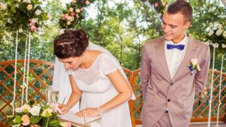 Married couple signing the Register