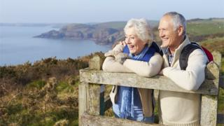 older man and woman on cliff top