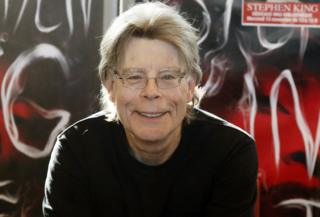 Stephen King posing for cameras during a promotional book tour in Paris on 13 November 2013.