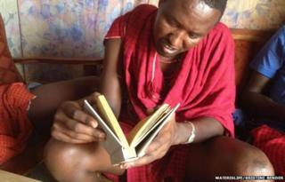 A man leafing through the book