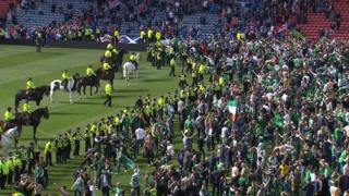 Fans and police in Hampden Park