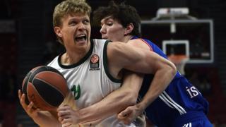 Mindaugas Kuzminskas playing basketball for the Malaga club in Spain